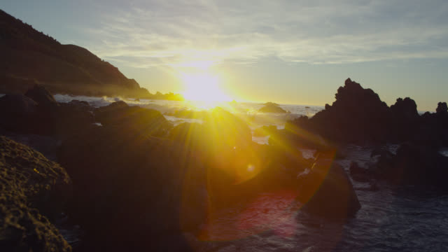 Rocky coast at sunset, New Zealand