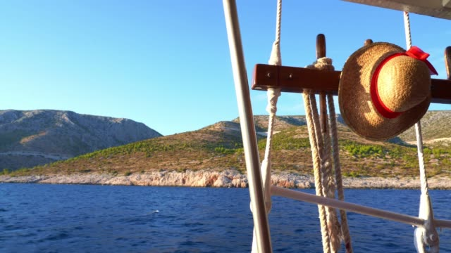rocky coast of the island hvar, view from the boat - straw hat stock videos & royalty-free footage