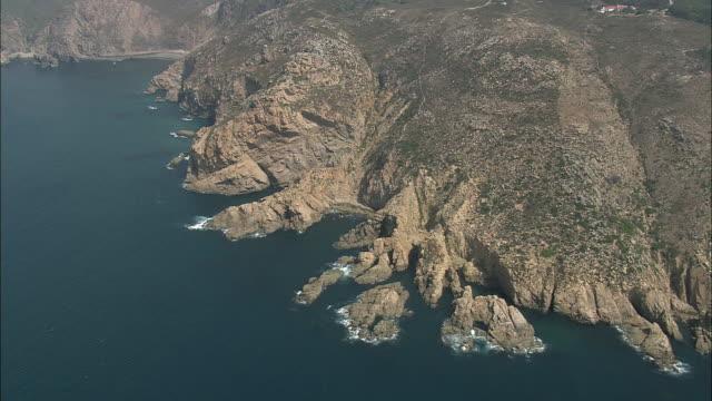 aerial ws rocky coastal edge north to cabo da roca / cascais, lisbon, portugal - cascais stock videos and b-roll footage