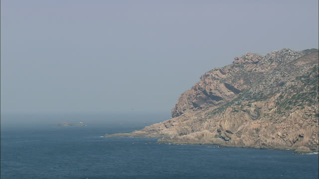 aerial ws rocky coastal edge north to cabo da roca, with lighthouse / cascais, lisbon, portugal - cascais stock videos and b-roll footage