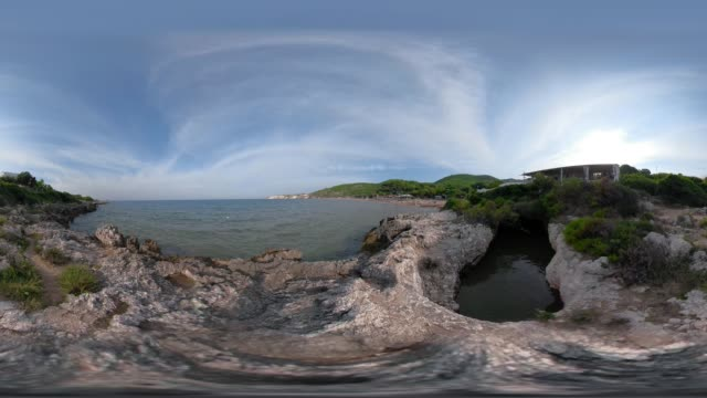 360 vr / rocky coastline at baia san nicola beach at the adriatic sea - 360 video stock videos & royalty-free footage