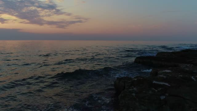 rocky coastline at sunset - mare adriatico video stock e b–roll
