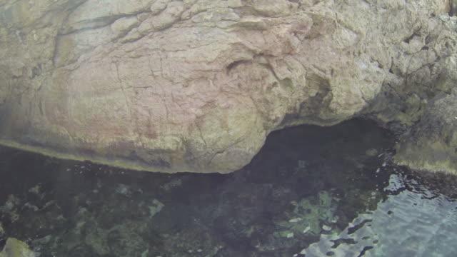 rocky coastline close-up in ibiza, spain - rocky coastline stock videos & royalty-free footage