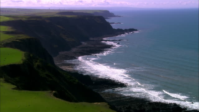 low aerial, rocky coastline, devon, england - devon stock videos & royalty-free footage