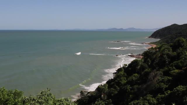 rocky coastline in a sunny day - südbrasilien stock-videos und b-roll-filmmaterial