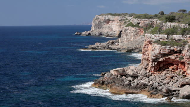 rocky coastline in the south of mallorca - rocky coastline stock videos & royalty-free footage