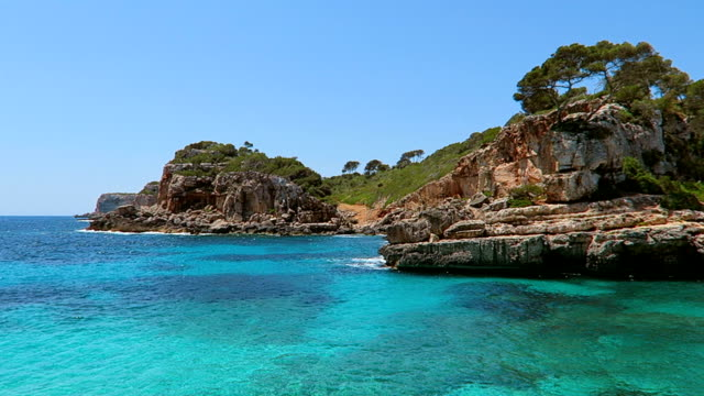 Rocky coastline of Cala s'Almunia on east coast on Spanish Balearic island of Majorca / Spain