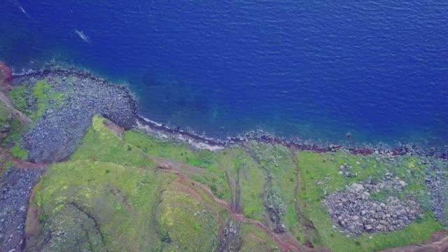 rocky, coastline of santorini. aerial view - santorini stock videos and b-roll footage