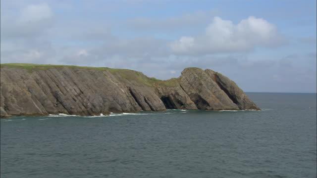low aerial, rocky coastline, pembrokeshire, wales - pembroke video stock e b–roll