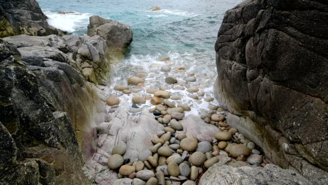 rocky cove with boulders, porth nanven, penzance, cornwall, england, united kingdom, europe - coastal feature stock videos & royalty-free footage