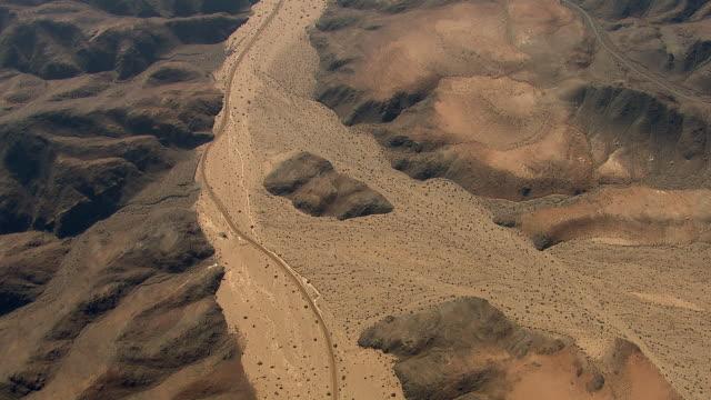 Rocky Desert Terrain And Dry River