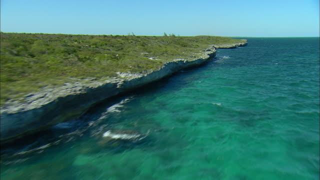 aerial rocky eroded cliffs on shoreline of channel island, near eleuthera island, bahamas - coastline stock videos & royalty-free footage