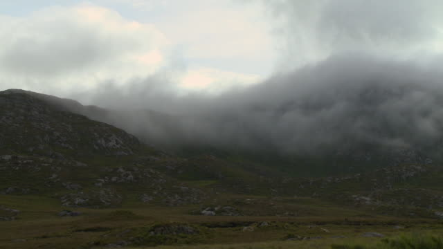 rocky grassy hills and fog - steep hill stock videos & royalty-free footage