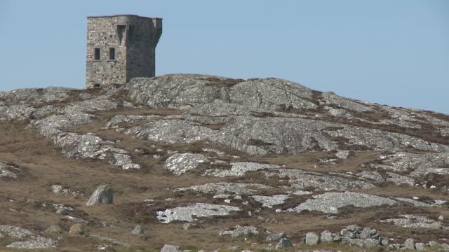 rocky hill leading to brick tower - hill点の映像素材/bロール