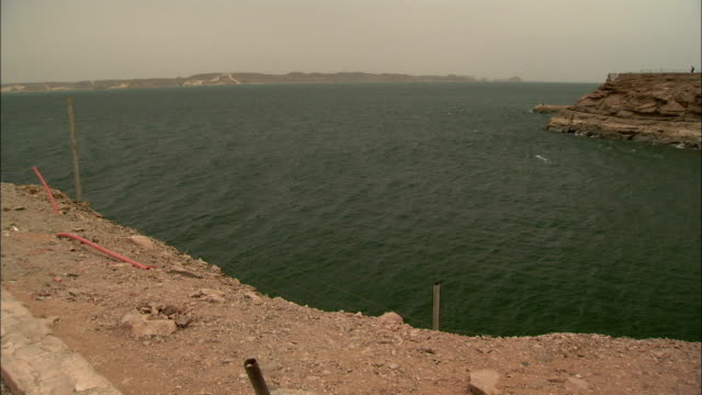 A rocky hill overlooks a reservoir in Egypt. Available in HD.