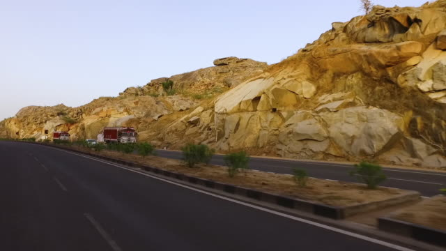 rocky hills alongside road - roadside stock videos and b-roll footage