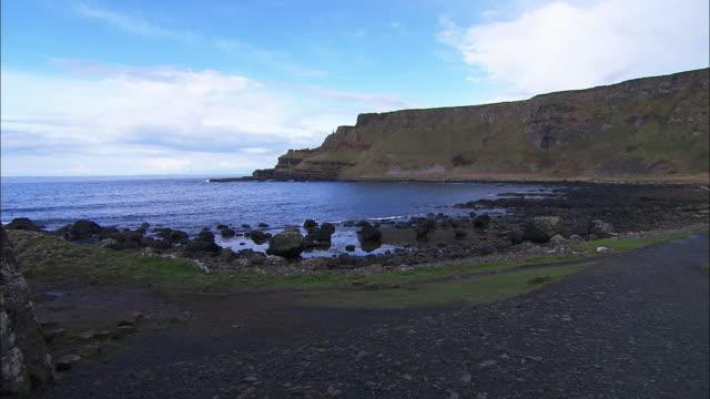 rocky irish coast, giants causeway, northern ireland - causeway stock videos & royalty-free footage