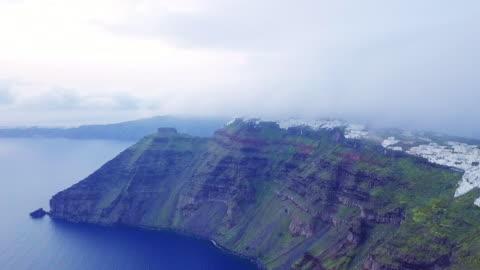 rocky, island coastline of santorini. aerial view - santorini stock videos & royalty-free footage