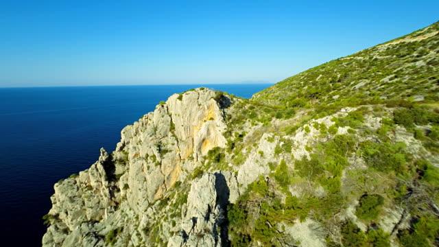 aerial rocky island - steep stock videos & royalty-free footage