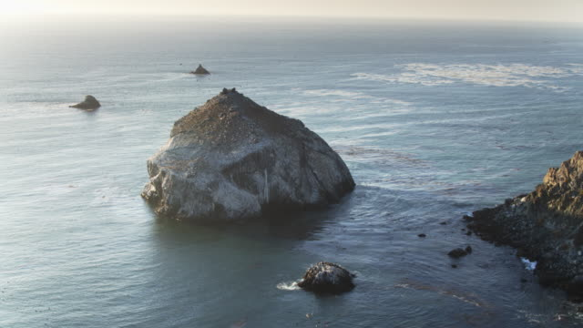 rocky islands off big sur coast at sunset - drone shot - monterey county stock videos and b-roll footage