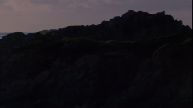 rocky islets and outcroppings lie along the coast of a channel island. - boulder stock videos & royalty-free footage