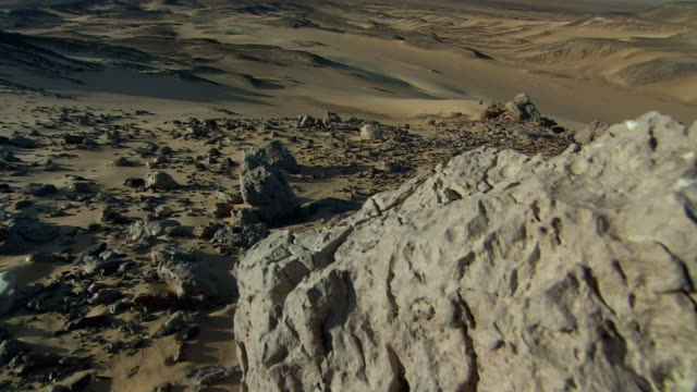 a rocky landscape in the sahara desert. available in hd. - sahara desert stock videos & royalty-free footage