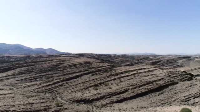 rocky landscape with reddish soil. planet surface - surrealism stock videos & royalty-free footage