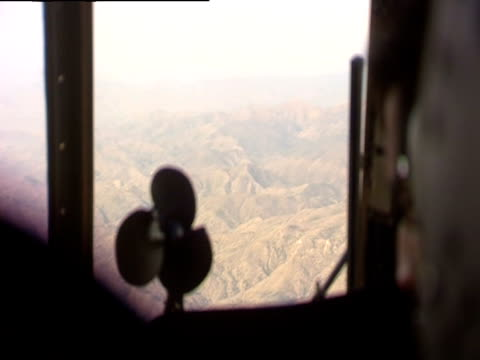 rocky mountains from helicopter pilot view - helicopter pilot stock videos & royalty-free footage