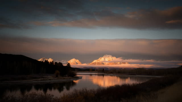 rocky mountains reflected in snake river, grand teton national park, wyoming - rocky mountains north america stock videos & royalty-free footage