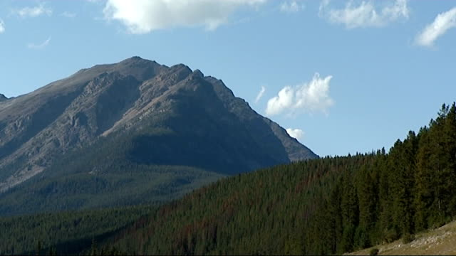 rocky mountains scenery from train; more of lakes and mountain scenery seen from moving train - rocky mountains stock videos & royalty-free footage