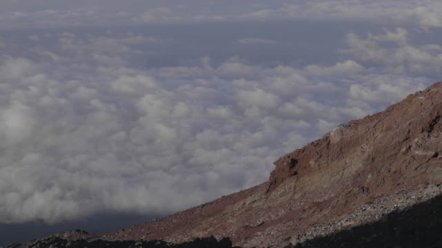 rocky mt. fuji mountainside above clouds, wide - satoyama scenery stock videos and b-roll footage
