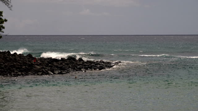 rocky outcrop on edge of kauai island - butte rocky outcrop stock videos & royalty-free footage