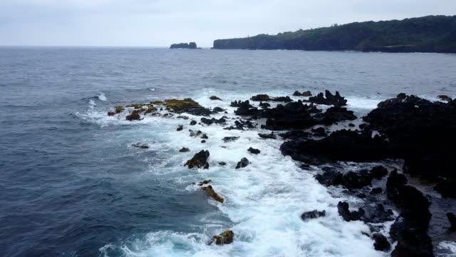Rocky Outcrop on Maui Island and Waves Crashing Over Rocks