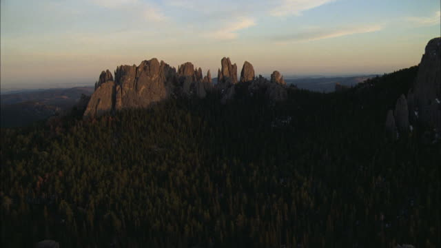 aerial rocky outcroppings and evergreen forests in mountain foothills / south dakota, united states - south dakota stock videos and b-roll footage