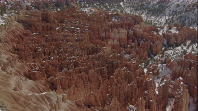 rocky pinnacles create a cathedral effect in bryce canyon. available in hd. - bryce canyon bildbanksvideor och videomaterial från bakom kulisserna