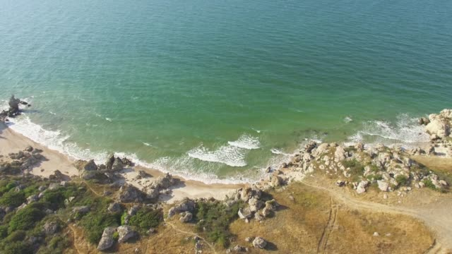 AERIAL: Rocky sea coast