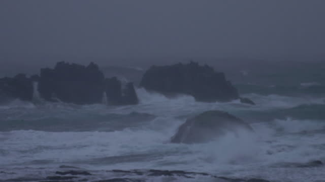 rocky sea in snowstorm, hokkaido, japan - coastal feature stock videos & royalty-free footage