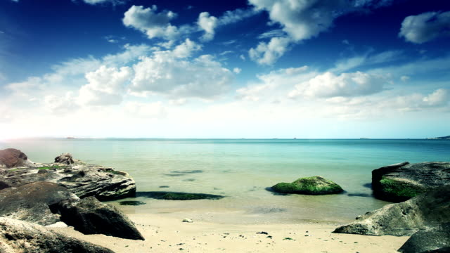 Rocky seaside against blue moody clouds