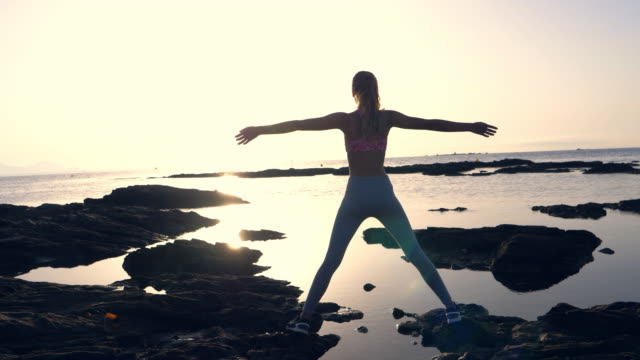 rocky shore training. pure joy. open arms - arms outstretched stock videos & royalty-free footage