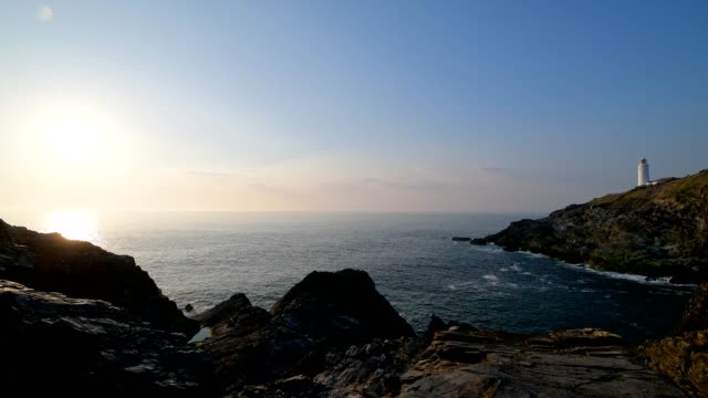 rocky shore with trevose head lighthouse at sunset, trevose head lighthouse, padstow, cornwall, england, united kingdom, europe - cape stock videos & royalty-free footage