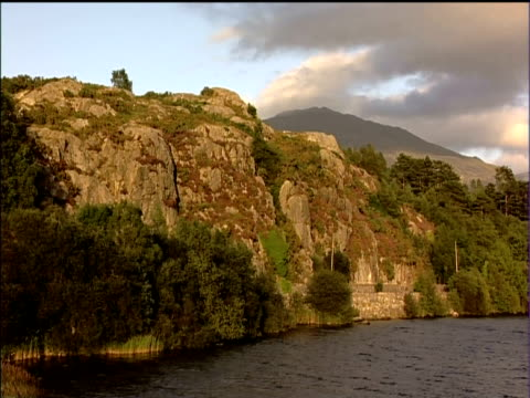rocky shoreline of lake in snowdonia national park - snowdonia stock videos & royalty-free footage