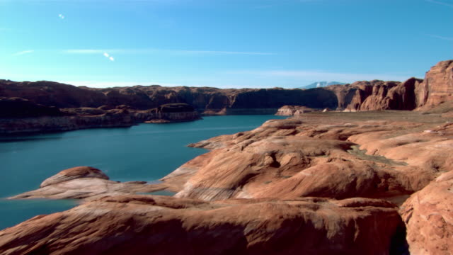 a rocky shoreline surrounds lake powell in glen canyon national recreation area. - lake powell stock videos & royalty-free footage