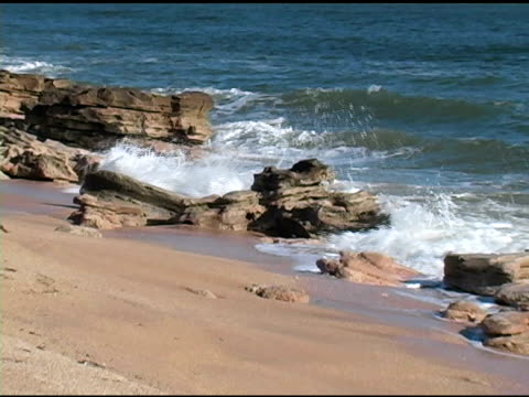 rocky shoreline zoom out - surf rock stock videos & royalty-free footage