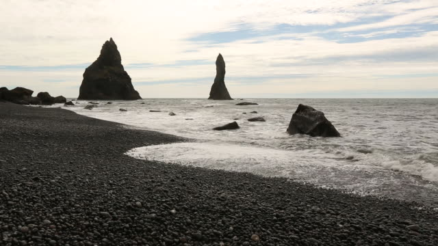 Rocky spires off the ocean coast in Iceland