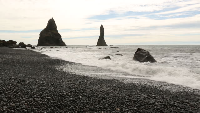 rocky spires off the ocean coast in iceland - reykjavik stock videos and b-roll footage