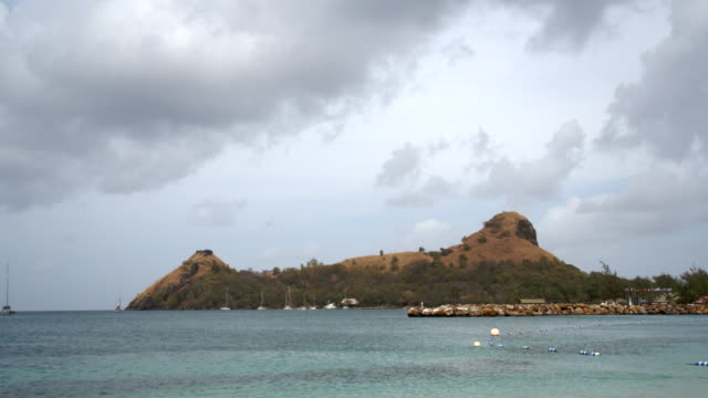 rocky terrain across the sea / st lucia, caribbean - 固定された点の映像素材/bロール