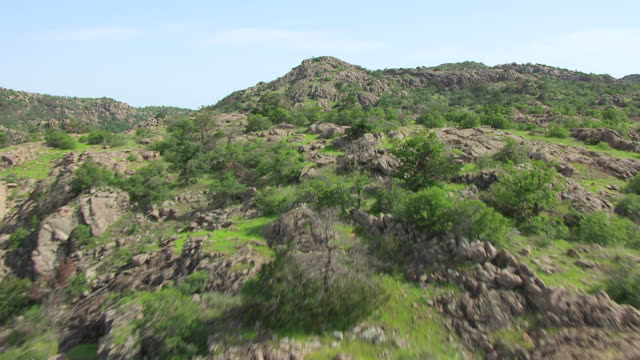 ws aerial rocky terrain and wichita mountains / oklahoma, united states - wichita stock-videos und b-roll-filmmaterial