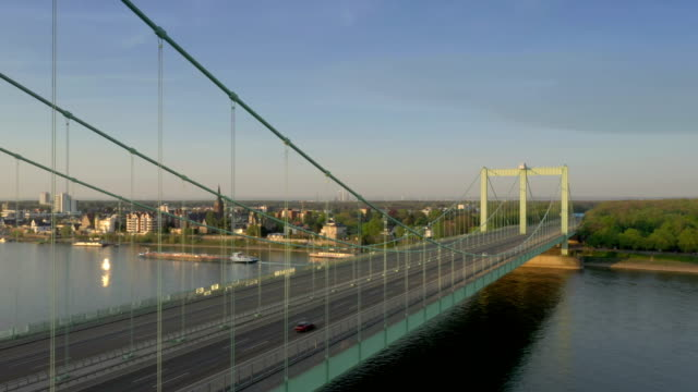 rodenkirchener brücke at sunrise - suspension bridge stock videos & royalty-free footage