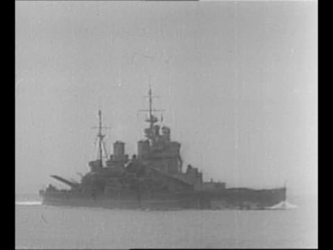 rodney sails in north atlantic during patrol for german ships during world war ii / bow and gun turrets of rodney as waves break over / hms king... - battle stock-videos und b-roll-filmmaterial