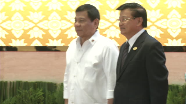 rodrigo duterte president of the philippines is greeted by the laos prime minister thongloun sisoulith and wife at the association of southeast asian... - association of southeast asian nations stock videos & royalty-free footage